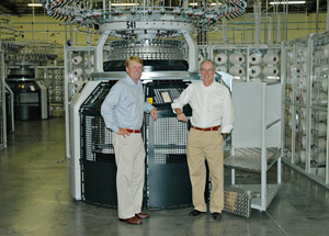 Iv Culp (on the left) and Blair Barwick in the Culp production line in the USA in front of a Mayer & Cie. circular knitting machine model OVJA 1.6 EM.