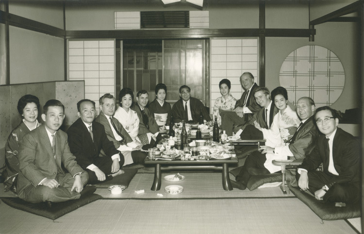 Karl Mayer (back right) with employees, agents and Japanese customer in the 60s