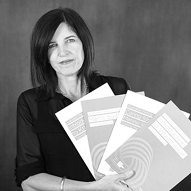 The Woolmark Company's Group Manager Trade Education, Julie Davies, displaying the new introductory training manuals.