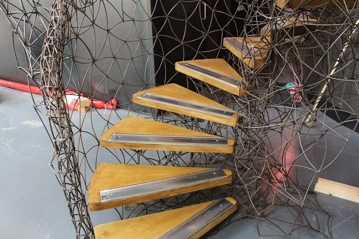 Albion's extravagantly sculpted metal staircase incorporates needle beds from redundant hand flat knitting machines.