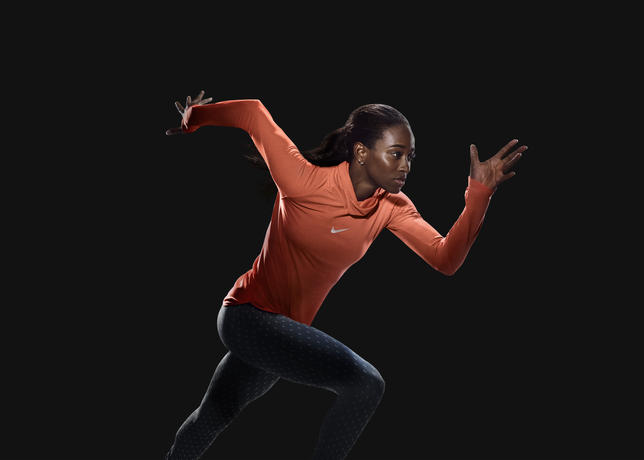 Wearing the women's Nike AeroReact Pullover Top is English Gardner: World Championships Silver Medalist, 4x100m