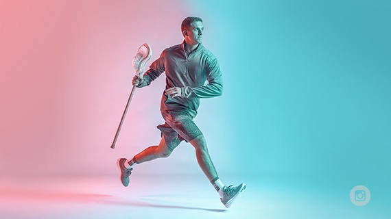 The Warp is a lacrosse stick incorporating an engineered flat knitted net knitted on a Stoll CMS flat knitting machine. © Warrior Sports/New Balance