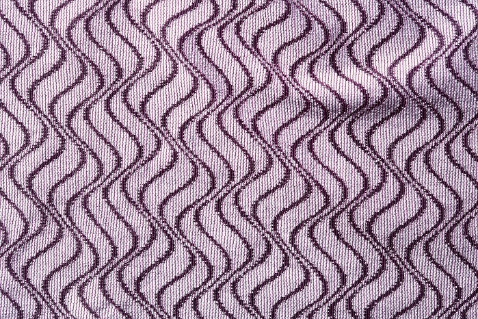 Raschel-knitted fabrics with geometric patterns and two-colour effects produced by the package dyeing of polyamide and Tencel. © Karl Mayer
