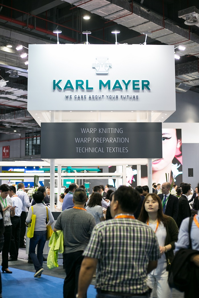 Visitors to Karl Mayer's stand at ITMA Asia + CITME. © Karl Mayer