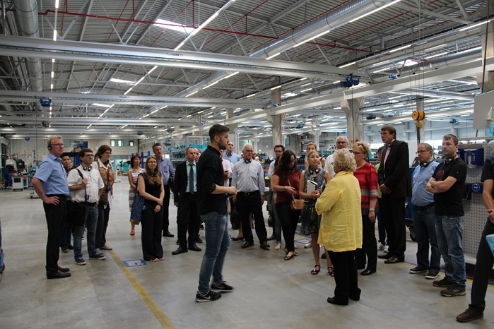 Guests are shown around the around the new assembly hall. © Karl Mayer