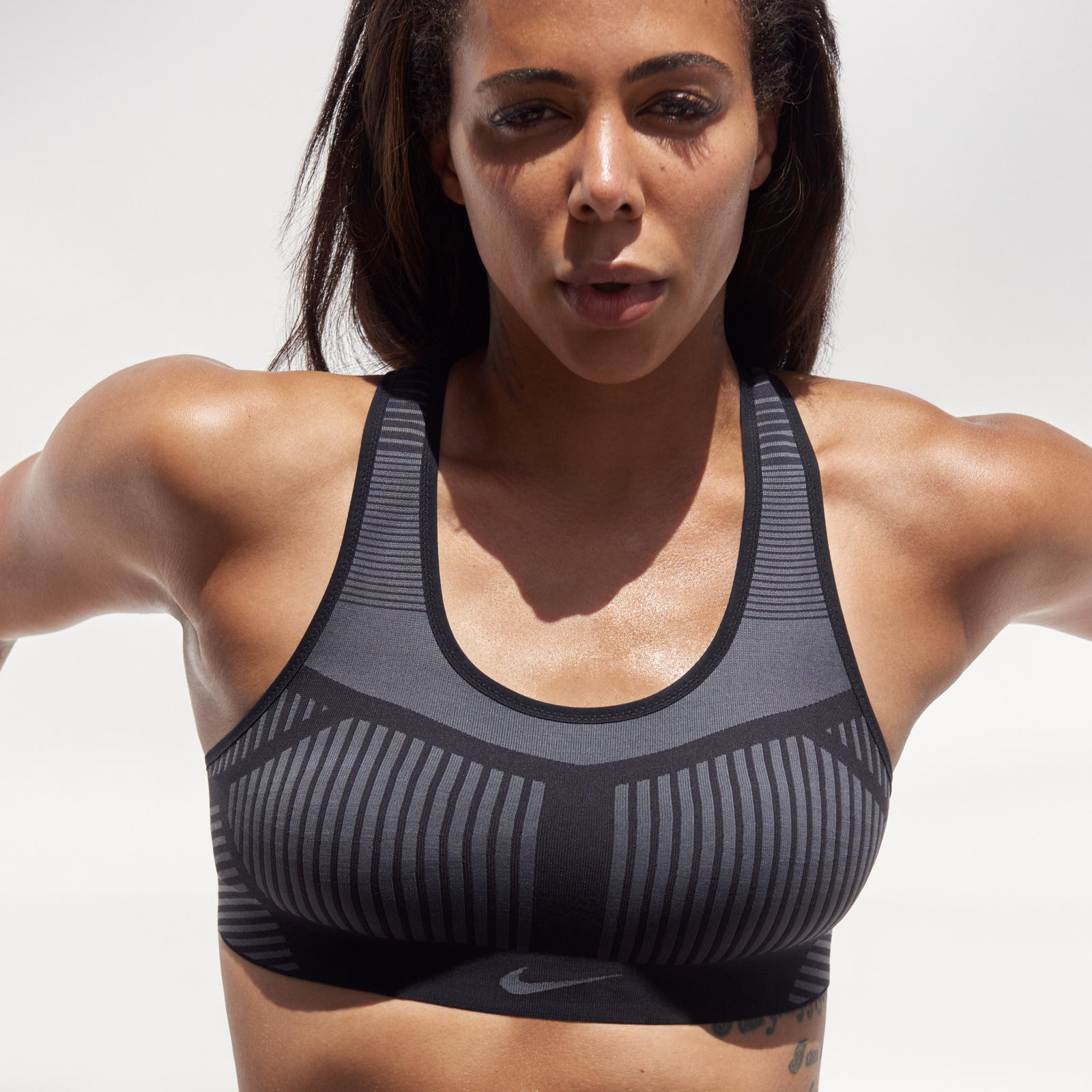 """Some sports bras keep me so locked in that it's almost hard to breathe. But when I wear the Nike FE/NOM Flyknit Bra I feel free, like I can move around but still be completely supported,"