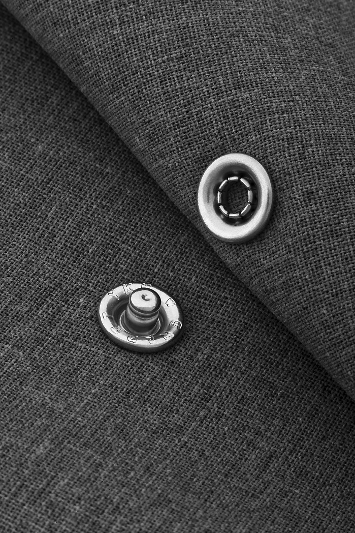 YKK's Snap and Button product ranges are used as an enhancing support across a range of fabrics and garments. © YKK London Showroom