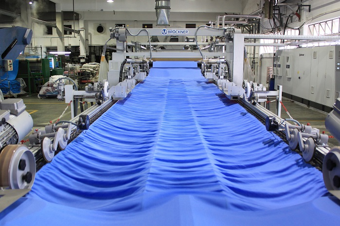 View of the stentering zone in front of the relaxation dryer. © Brückner Textile Machinery/ Tropic Knits Group