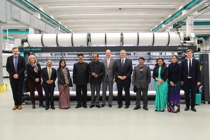 The Indian Minister of State for Textiles, Ajay Tamta, and the Secretary Government of India, Ministry of Textiles, Anant Kumar Singh, with their accompanying delegation, side by side with Karl Mayer's CFO, Dr Helmut Preßl, as well as other Karl Mayer employees. © Karl Mayer