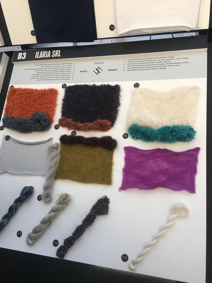 Colourful accents gave a new look to the dark tones in fabrics which were knitted up or woven into samples from the yarns on show. © Janet Prescott