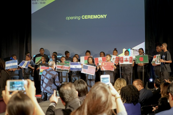 Flag Ceremony with kids from Meyga Learning Center welcoming seven countries. © Apparel Textile Sourcing Miami