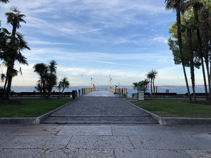 Lake Garda from Sirmione. Castel Goffredo is a 'comune' in the province of Mantua, in Lombardy, northern Italy. It lies 35 kilometres from Mantua and a few more from Brescia in a region of springs at the foot of the slopes that drain into beautiful Lake Garda. © Knitting Industry