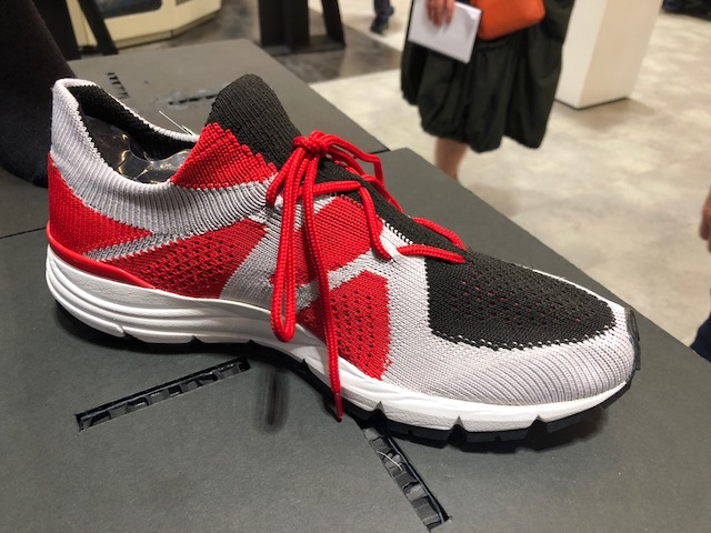 At ITMA 2019 Santoni showed its latest Argyle shoe upper machines. The XT Machine has true transfer stitch capability (no run holes) and can knit selected terry in the same course. © Knitting Industry.