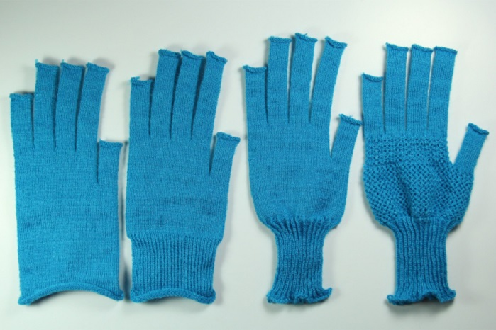 Researchers at MIT demonstrated gloves fabricated by a system for automating knitted garments. © MIT CSAIL