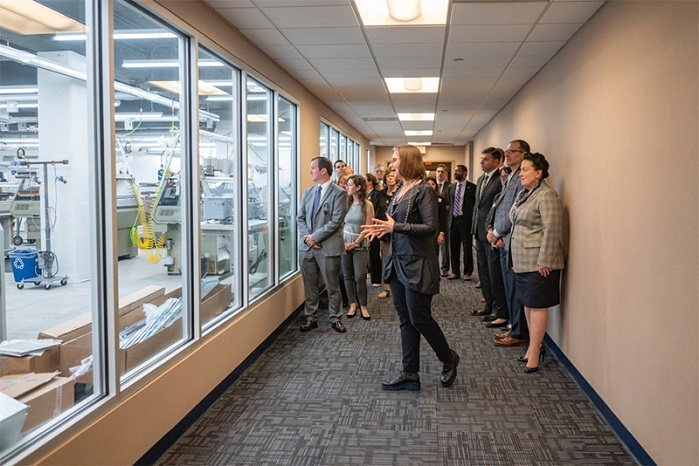Director Geneviève Dion leads tour guests, as they view the manufacturing space for the first time before entering. © Drexel University