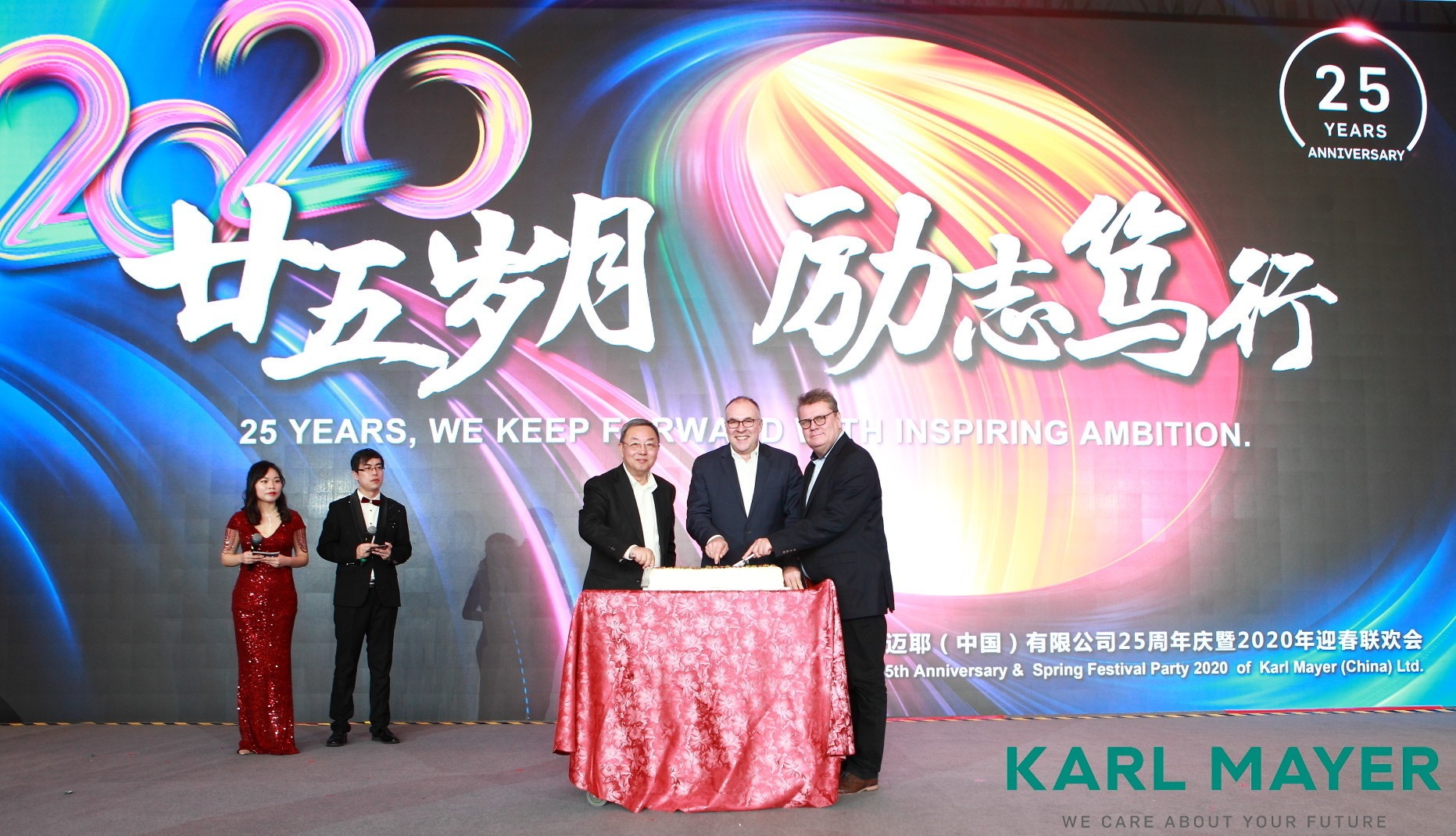 (from left to right, foreground): Yang Zengxing, General Manager of Karl Mayer(CHINA) as well as Arno Gärtner, CEO, and Roland Kohn, member of the extended Karl Mayer management team cut the birthday cake. © Karl Mayer.