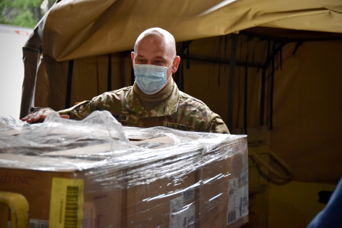A Virginia National Guard guardsman helps load a shipment of 50,000 Hanes face masks to be distributed in Henrico County, Virginia, over the Memorial Day weekend (Photo: Business Wire)